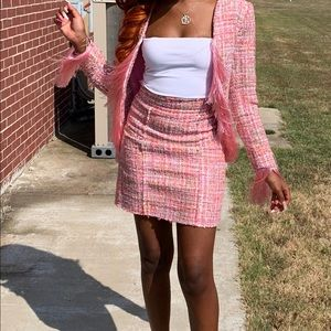Pink suit with fringe sleeves
